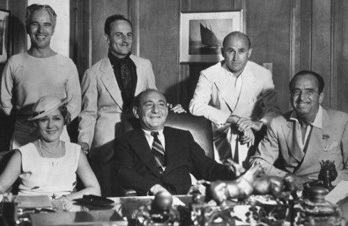 The United Artists in 1930. Clockwise from back - Charles Chaplin, Darryl Zanuck, Samuel Goldwyn, Douglas Fairbanks, Joseph Schenck and Mary Pickford